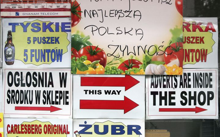 Polish advertisements in a shop window in a Polish area of London. The United Kingdom has seen a surge of immigrants from Pol