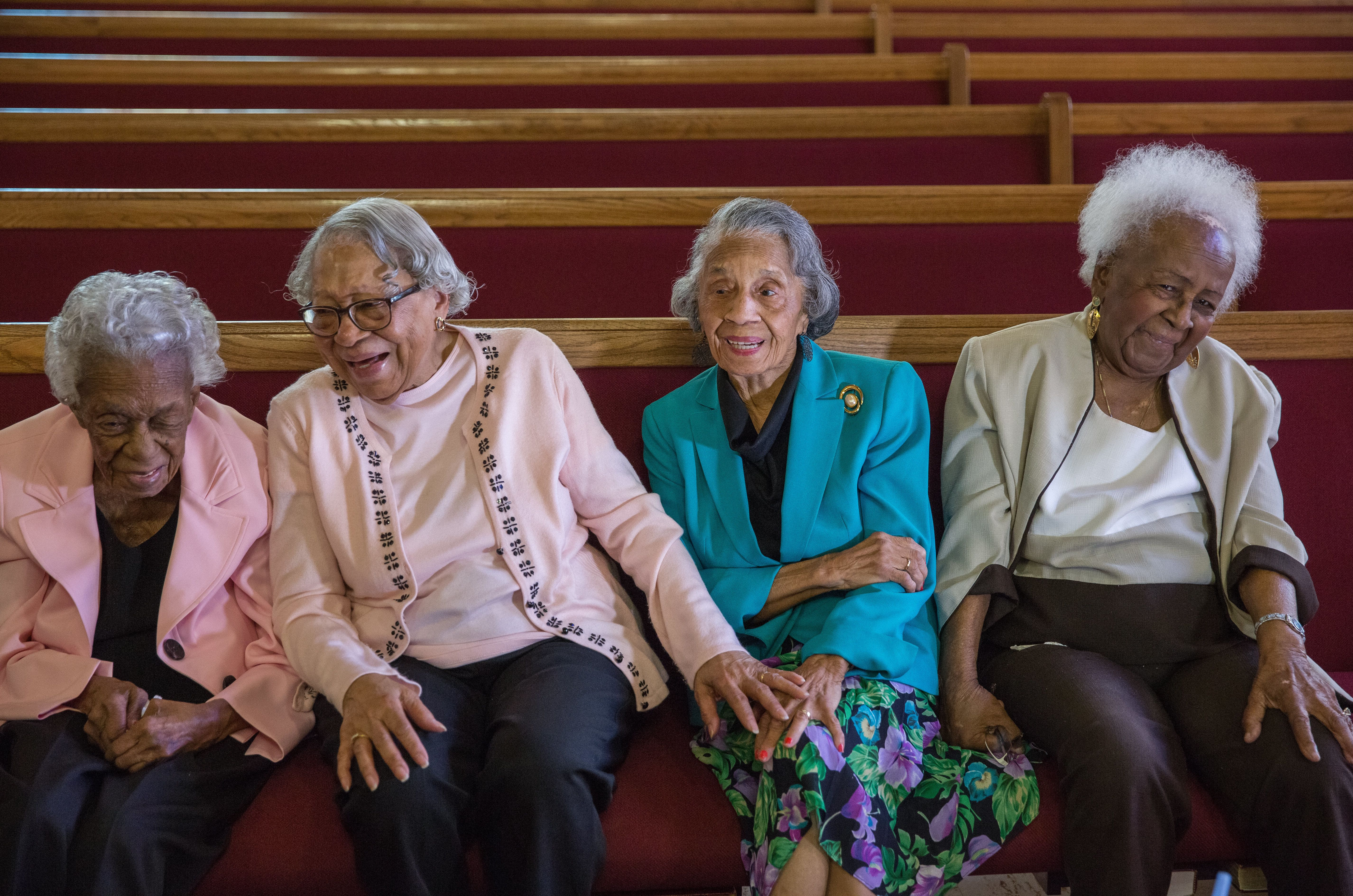 WASHINGTON, DC - MAR09:  (L-R) Ruth Hammett, Gladys Butler, Bernice Underwood, and Leona Barnes, who will all turn 100 this year, laugh as they reminisce during an interview, at Zion Baptist Church, March 9, 2016, in Washington, DC. These four women have been friends since they grew up together in southwest DC before the area was destroyed under eminent domain. (Photo by Evelyn Hockstein/For The Washington Post via Getty Images)