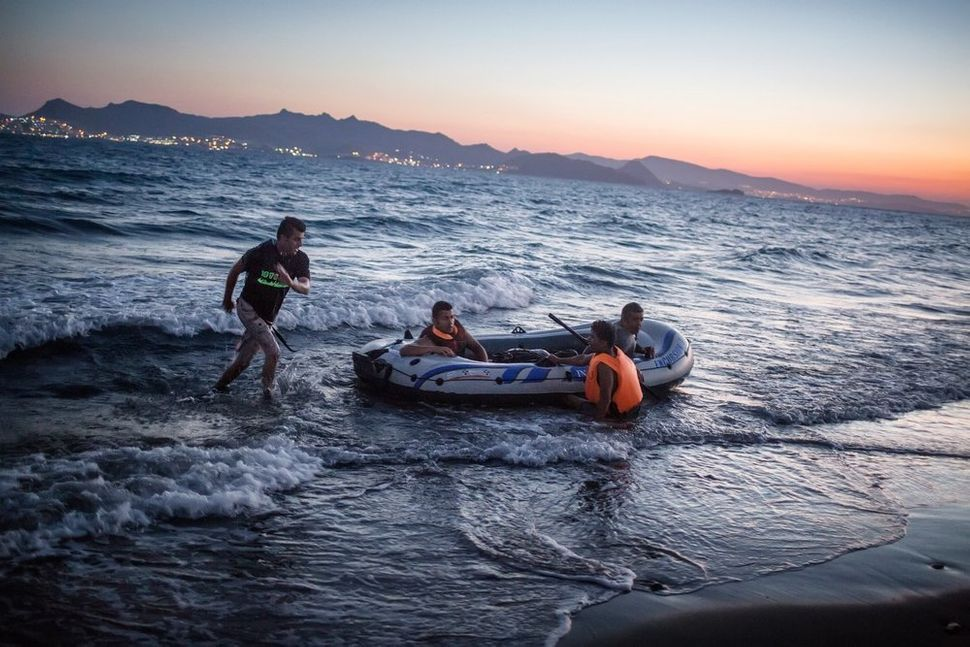 Refugees from Iraq arrive with low-quality plastic dinghies on the shores of the Greek island of Kos. They were forced t