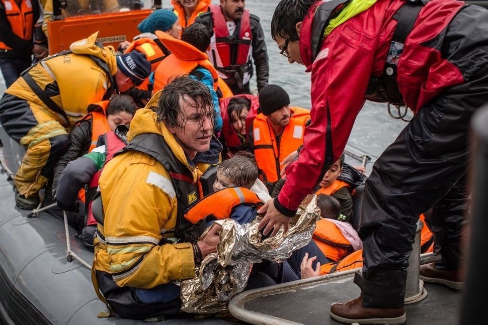 MSF and Greenpeace teams rush to the waters off Lesbos, where a wooden boat filled with refugees capsized. Frontex,