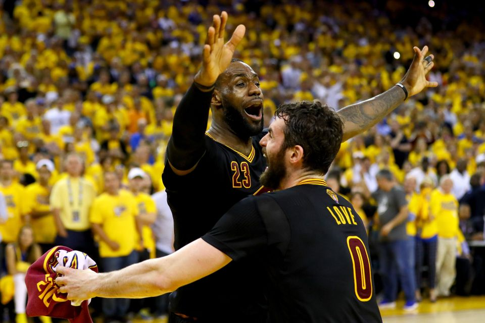 OAKLAND, CA - JUNE 19:  LeBron James #23 and Kevin Love #0 of the Cleveland Cavaliers celebrate after defeating the Golden St
