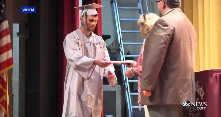 Scott Dunn receiving his diploma.