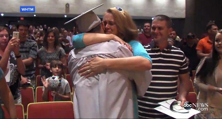 Karen hugs her son, Scott Dunn.