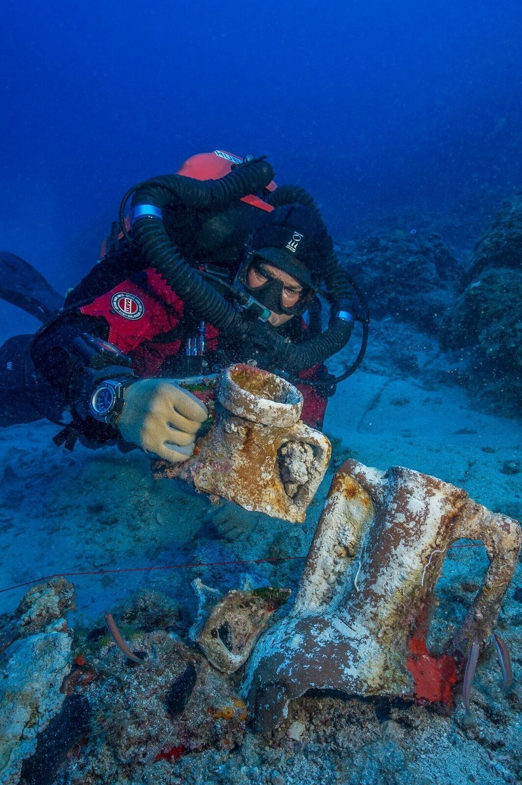 Foley, a marine archaeologist, compares amphora styles on the Antikythera shipwreck.