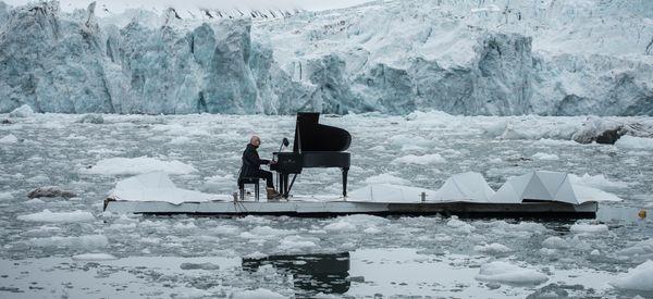 Composer Plays Haunting Elegy As Arctic Icebergs Crumble Around Him