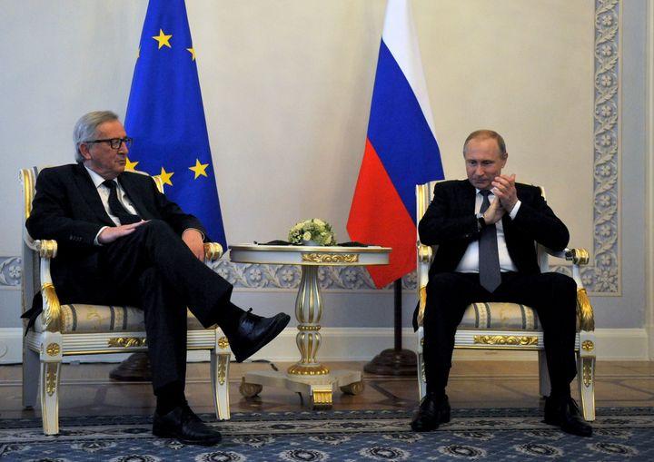 European Commission President Jean-Claude Juncker, left, met Russian PresidentVladimir Putinat St. Petersburg Int