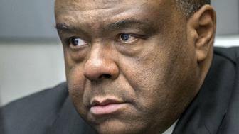 Former DRCongo leader Jean-Pierre Bemba Gombo waits in a court room of the ICC to hear the delivery of the verdict against him blamed for unbridled rapes and killings by his private army in neighbouring Central African Republic over a decade ago, on March 21, 2016 in The Hague. International judges on March 21, 2016 found former Congolese vice president Jean-Pierre Bemba guilty on all five counts of war crimes and crimes against humanity. / AFP / ANP / Jerry Lampen / Netherlands OUT        (Photo credit should read JERRY LAMPEN/AFP/Getty Images)