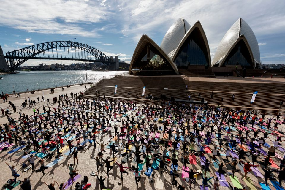 Thousand gather for a group yoga class in front of the Sydney Opera House on June 21, 2016 in Sydney, Australia. United Natio