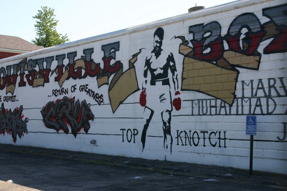 A mural of Muhammad Ali on the side of the Louisville TKO boxing gym in Louisville's Smoketown neighborhood, just blocks away