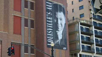 A sign honoring Muhammad Ali on the side of the Louisville Gas