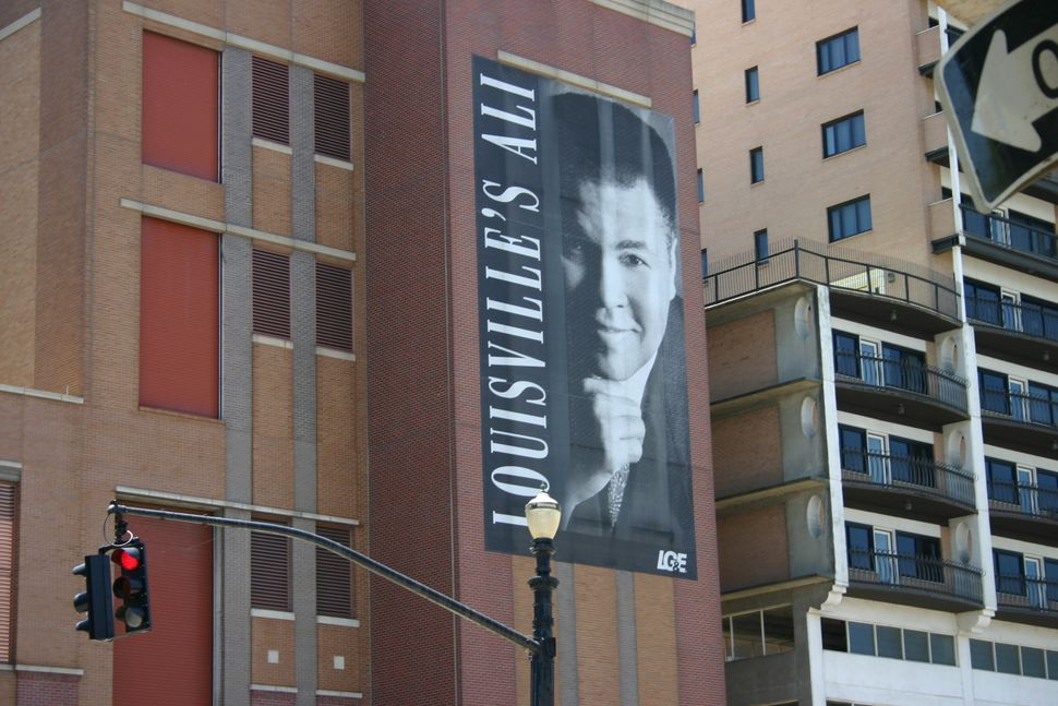 A local organization hung this banner honoring Ali downtown in 2002. It is visible to travelers on multiple highways that int