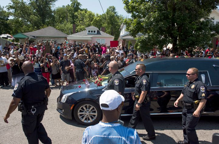 A crowd of more than 1,500 lined Grand Avenue on June 10 in front of the small pink house where Ali lived as a boy as his hearse passed through his neighborhood for the final time.