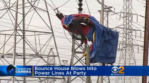 A bounce house sits in an electrical tower.