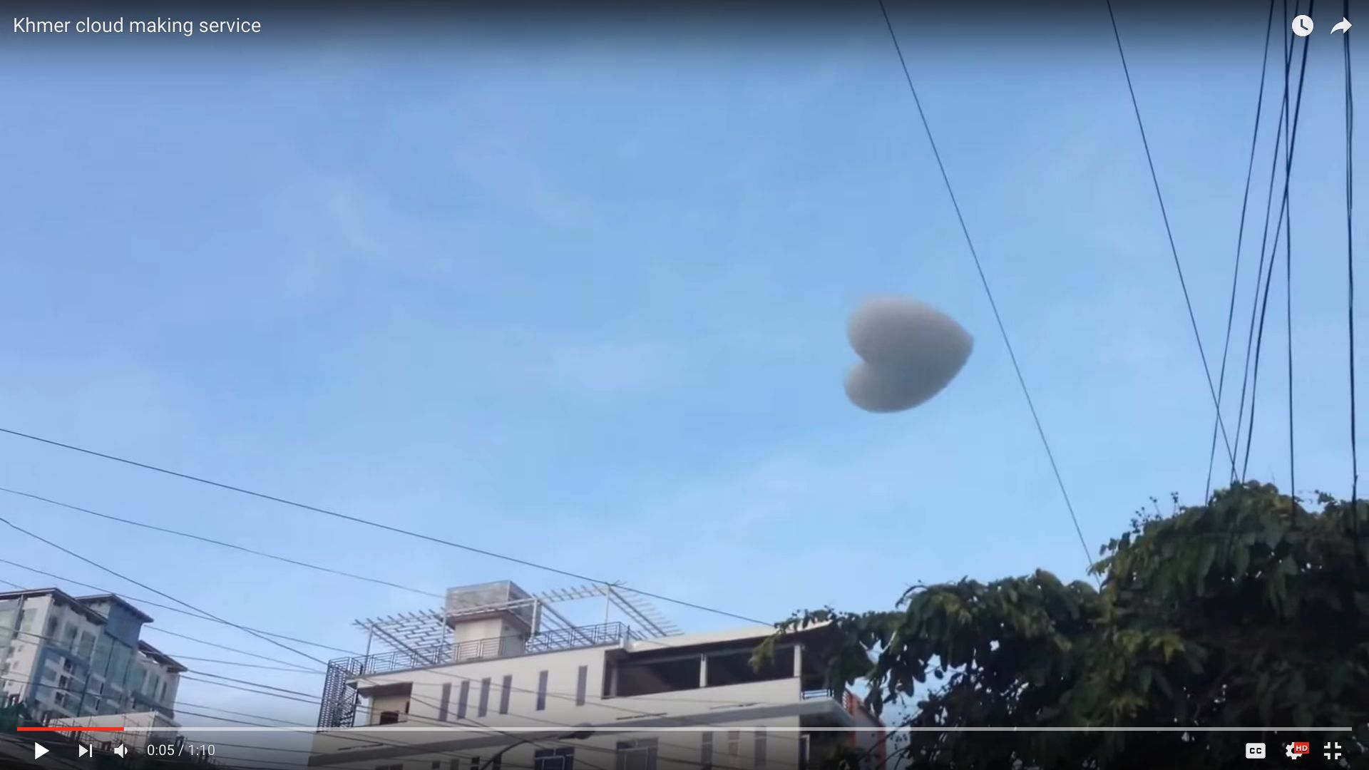 """A heart-shaped """"cloud,"""" composed of soap and helium, is seen floating away after its creation."""