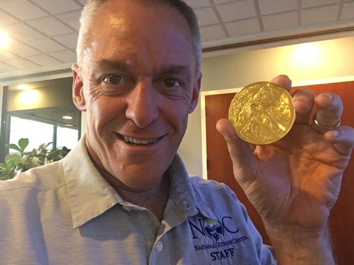 Canoeist Joe Jacobi, who won an Olympic gold medal in 1992 shows off his medal, shortly after the stolen medal was returned t