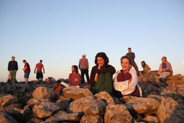 Israelis gather to watch the sunrise on the summer solstice, the longest day of the year, at Rujum el-Hiri located in the cen