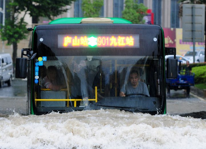 A bus goes through a flooded area in Jiujiang, Jiangxi Province, China, on June 19, 2016.