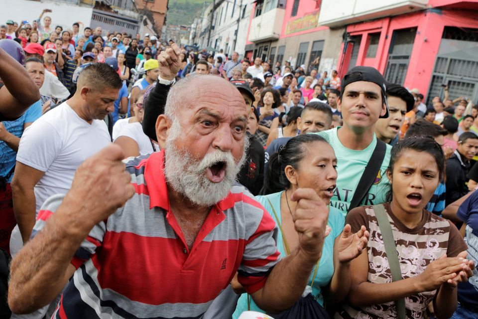 A man shouts during a protest over food shortage and against Venezuela's government in Caracas, Venezuela, on June 14, 2016.&