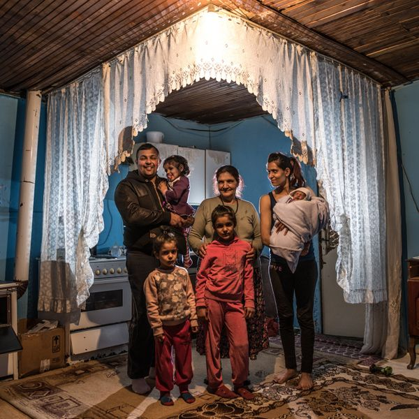 A family gathersat their home in a Roma settlement in Belgrade, Serbia, on March 14. Marginalized groups living in info