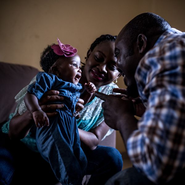 A fair chance in life begins with a strong, healthy start. In Nigeria, Remi Falayi (center), with her husband and daughter, 3