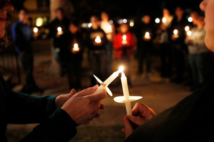 <i>Members of Queer Advocacy Network join with St. Paul&rsquo;s Church of Christ Thursday evening for a candlelight vigil.&nb