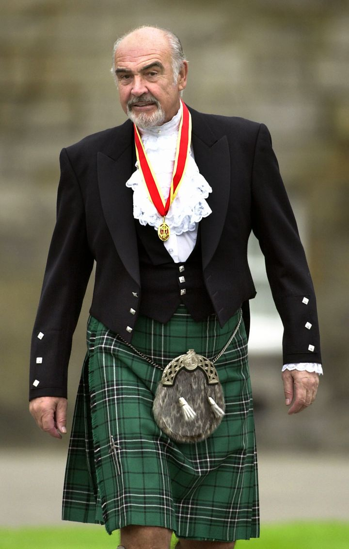 Sir Sean Connery wears full Highland dress and his medal after he was formally knighted by the queen in July of 2000.