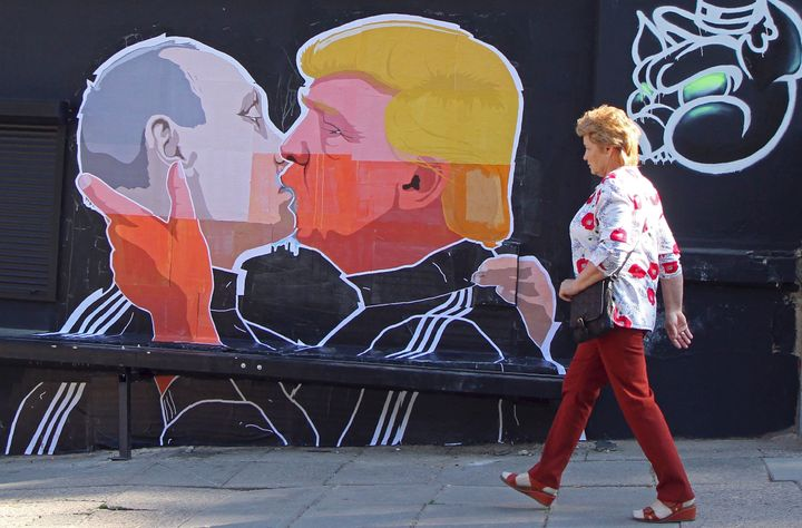 Donald Trump has shocked voters since the early days of the campaign with his praise for Russian President Vladimir Putin. Above, a woman walks past a mural of the two politicians on a restaurant wall in the Lithuanian capital of Vilnius.