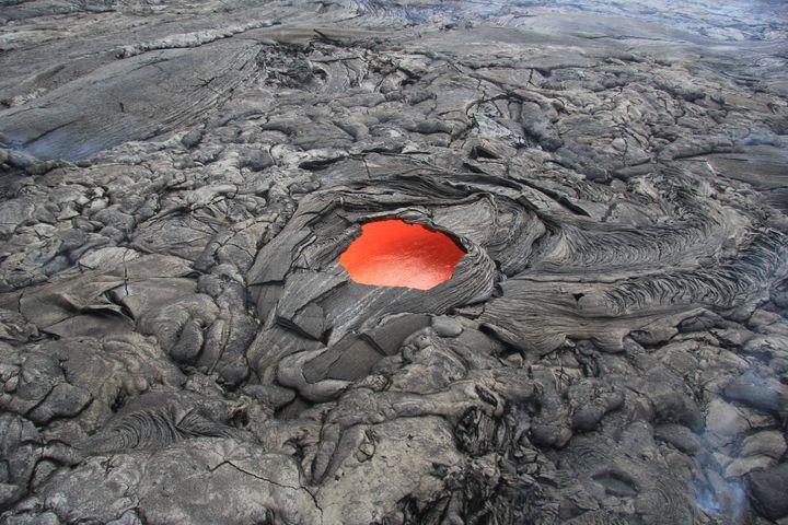 This lava skylight is an estimated 20 feet across.