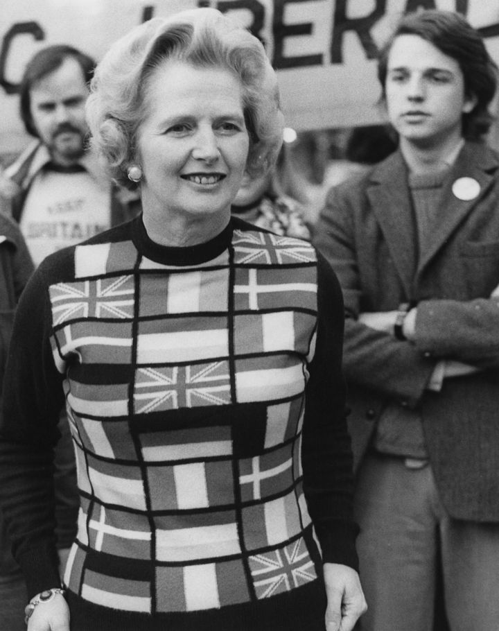 """Then-Conservative opposition leader Margaret Thatcher wears a sweater with European flags as she campaigns to """"Keep Britain i"""