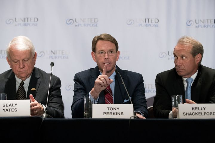 Flanked by Sealy Yates (L), founder of My Faith Votes, and Kelly Shackelford (R), president of the First Liberty Institute, Tony Perkins (C), president of the Family Research Council, speaks during a press conference following a meeting with Republican presidential candidate Donald Trump at the Marriott Marquis Hotel, June 21, 2016 in New York.