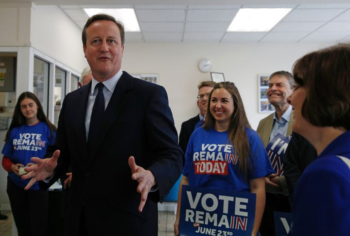 "Britain's Prime Minister David Cameron speaks with campaign volunteers for the ""Stronger In"" campaign in on Tuesday. The"