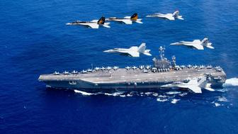 A combined formation of aircraft from Carrier Air Wing (CVW) 5 and Carrier Air Wing (CVW) 9 pass in formation above the Nimitz-class aircraft carrier USS John C. Stennis (CVN 74) in the Philippine Sea on June 18, 2016.     Courtesy Steve Smith/U.S. Navy/Handout via REUTERS  ATTENTION EDITORS - THIS IMAGE WAS PROVIDED BY A THIRD PARTY. EDITORIAL USE ONLY