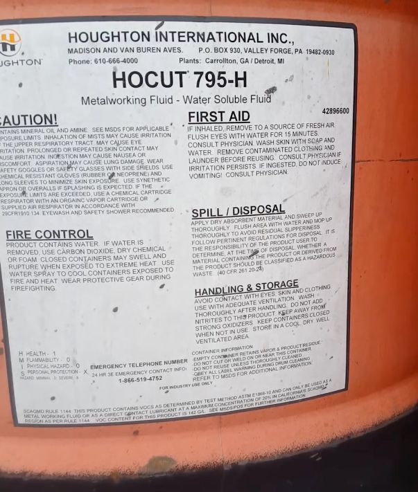 The barrel's label identifies the contentsas Hocut 795-H. According to its manufacturer, Houghton International, Inc.,