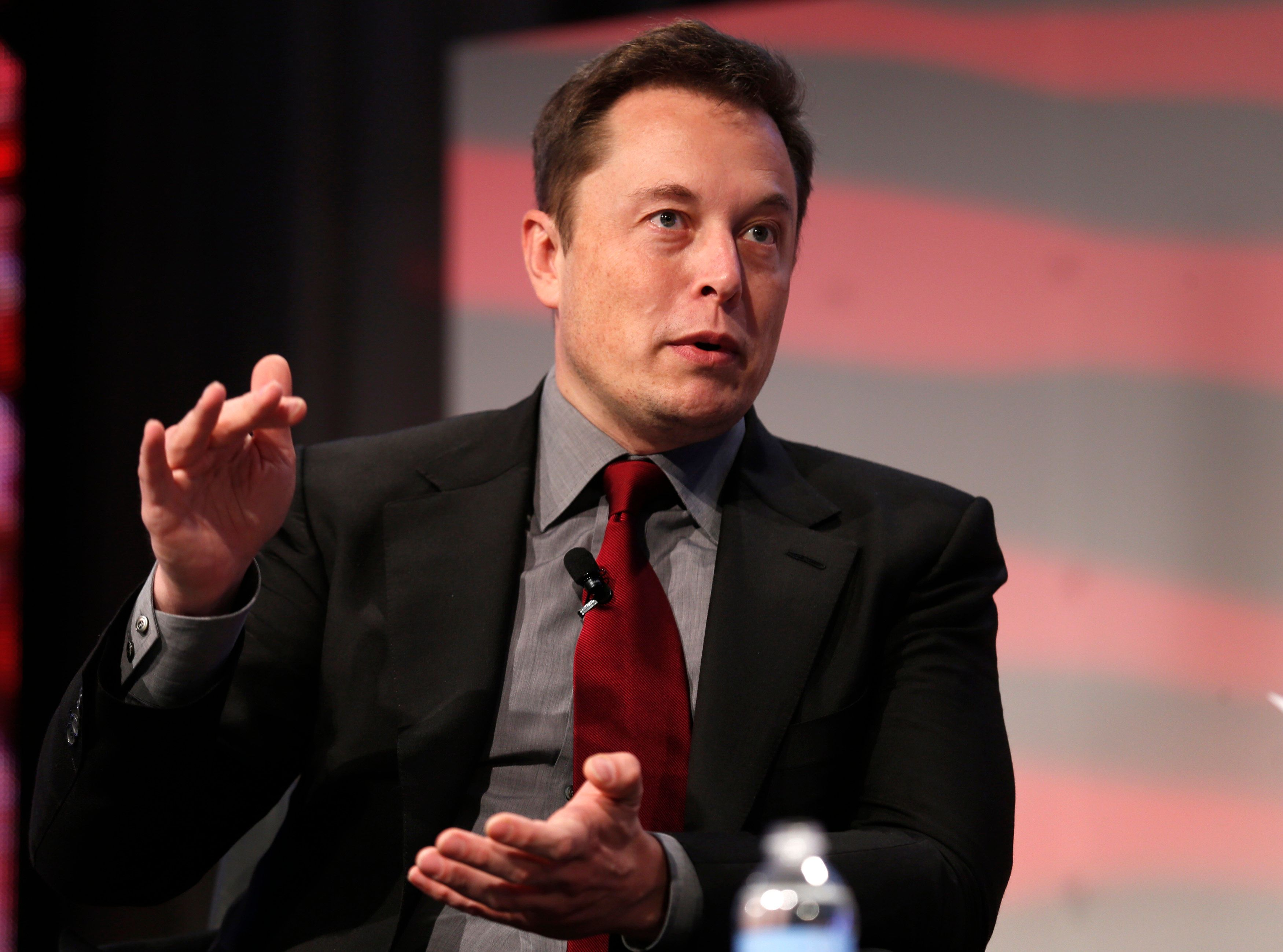 """Tesla Motors CEO Elon Musk talks at the Automotive World News Congress at the Renaissance Center in Detroit, Michigan, January 13, 2015. Tesla Motors Inc plans to boost production of electric cars to """"at least a few million a year"""" by 2025 from fewer than 40,000 last year, Musk said Tuesday. Picture taken January 13, 2015.    REUTERS/Rebecca Cook   (UNITED STATES - Tags: TRANSPORT BUSINESS)"""