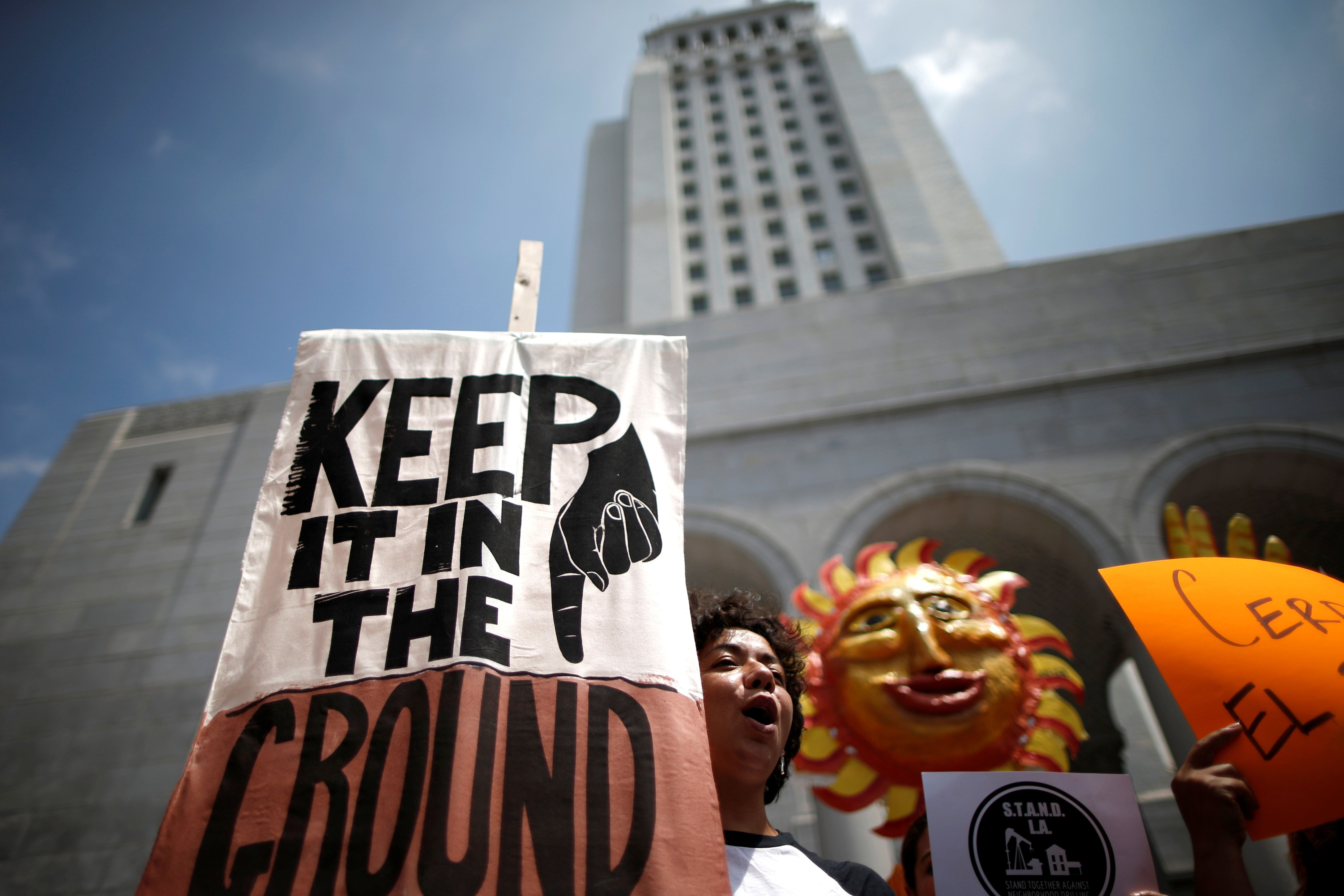 People protest against fracking and neighborhood oil drilling in Los Angeles, California, U.S., May 14, 2016. REUTERS/Lucy Nicholson