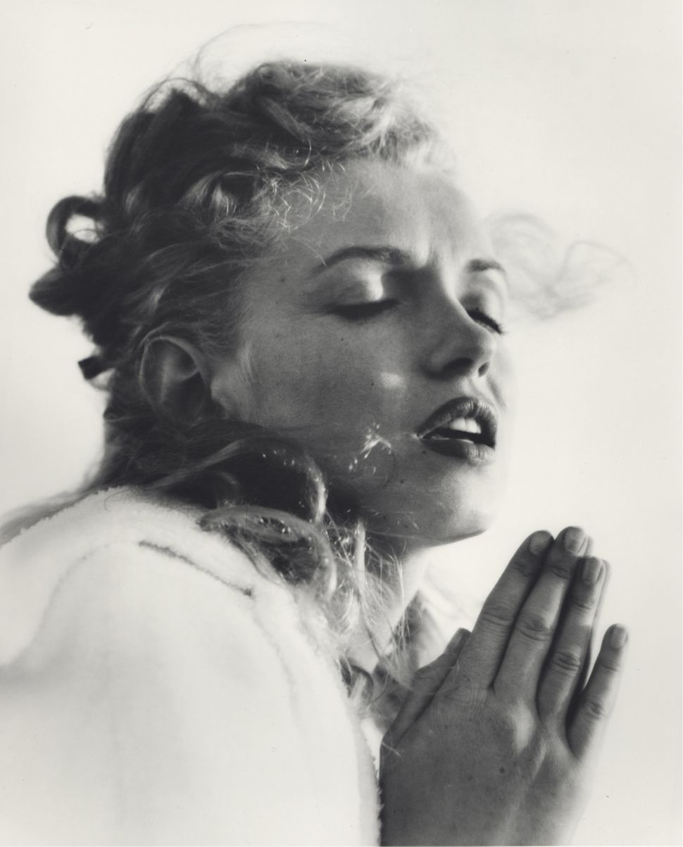 In 1945, Andre de Dienes was the first professional photographer to  work with Monroe when she was known simply as Norma