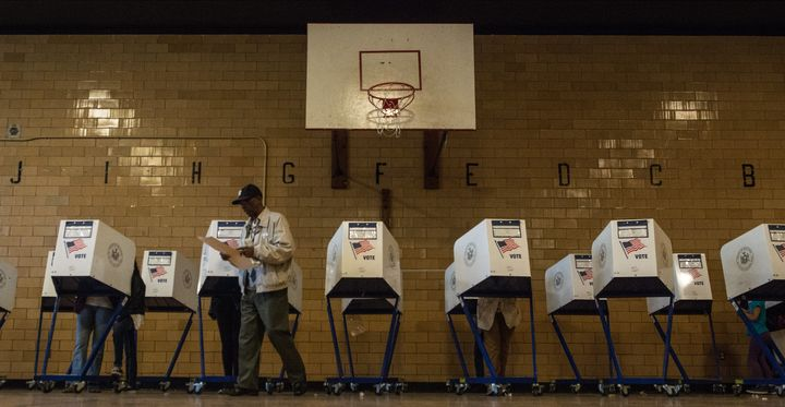 People vote at Public School 22 on April 19 in the Brooklyn borough of New York City.