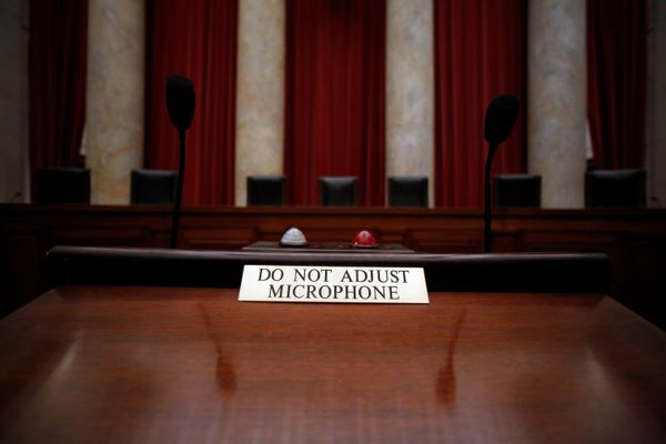 A notice is seen on a lectern where lawyers stand to argue before the Supreme Court justices.