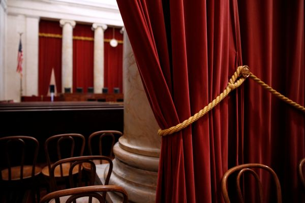 Red velvet drapes hang at the back of the courtroom at the U.S. Supreme Court building June 20, 2015.