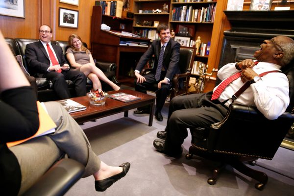 U.S. Supreme Court Justice Clarence Thomas jokes with his clerks as he describes their decision-making process in his chamber
