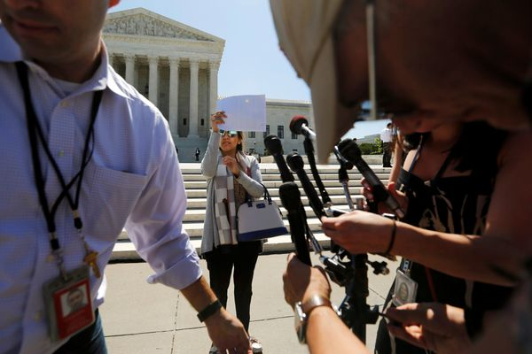 Television journalists prepare for a news conference on the plaza in front of the U.S. Supreme Court building on June 9, 2016