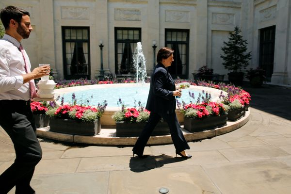 U.S. Supreme Court Justice Elena Kagan walks with her clerks in one of the four inner courtyards at the Supreme Court buildin