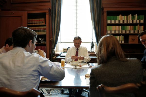 U.S. Chief Justice John Roberts eats a bowl of soup as he sits down to lunch with his team of clerks in his private study at