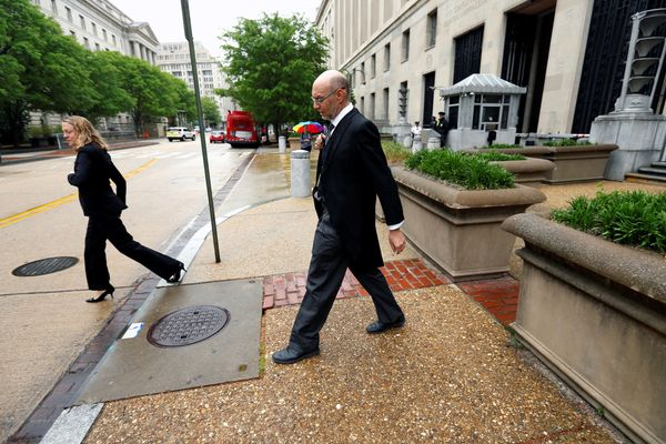 U.S. Deputy Solicitor General Michael Dreeben departs the U.S. Justice Department in traditional morning coat on his way to a