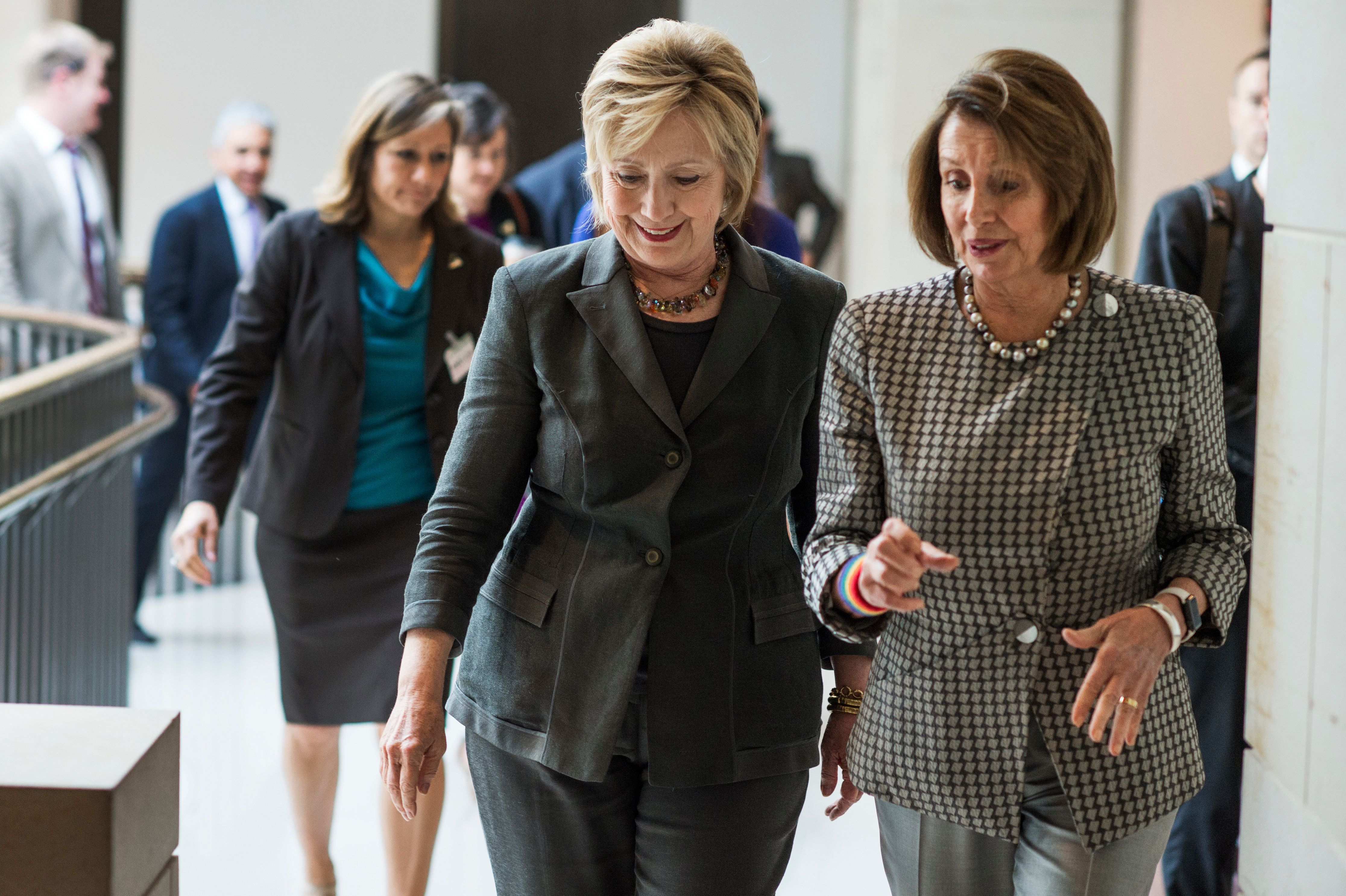 UNITED STATES - JUNE 22: Democratic presidential candidate Hillary Clinton, left, and House Minority Leader Nancy Pelosi, D-Calif., leave a meeting with House Democrats in the Capitol Visitor Center, June 22, 2016. (Photo By Tom Williams/CQ Roll Call)