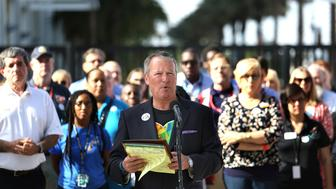 Orlando mayor Buddy Dyer delivers remarks during a press conference at Camping World Stadium, Friday, June 17, 2016 in Orlando. The mayor was joined by various charity and community agency workers and executives to update the public on assistance being offered to those affected by the Pulse massacre.   (Joe Burbank/Orlando Sentinel/TNS via Getty Images)