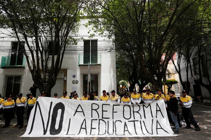 "Activists hold a banner that reads ""No to education reform"" in a demonstration after at least eight people were killed in cla"