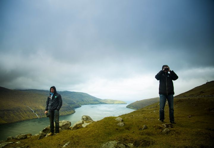 McCall, left, in the Danish Faroe Isles, with a Sea Shepherd volunteer at right. The serene landscape is a stark contras