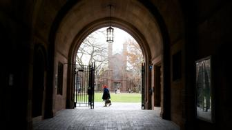 A woman walks through the Old Campus at Yale University in New Haven, Connecticut, November 28, 2012. REUTERS/Michelle McLoughlin (UNITED STATES - Tags: EDUCATION)