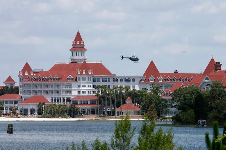 A Florida Fish and Wildlife Conservation Commission helicopter flies over the Seven Seas lagoon at Walt Disney World resort a